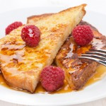French toast with raspberries and honey, close-up