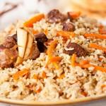 Uzbek national dish pilaf on plate