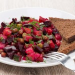 russian beetroot  salad with bread - vinaigrette, close-up